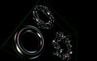 Shiny dark metallic material under multiple lights, with per-pixel lighting.
